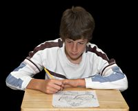 Boy Drawing Picture. An artistic young man drawing a picture Stock Photography