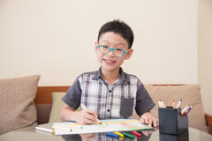 Boy drawing picture at home Royalty Free Stock Photo