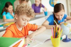 Boy drawing Stock Images