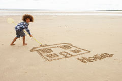 Boy drawing in sand Royalty Free Stock Image
