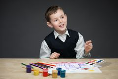 Boy drawing something Stock Image
