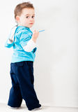 Boy drawing on the wall Stock Images