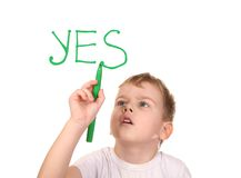 Boy drawing word YES by felt-tip pen, collage Royalty Free Stock Photo