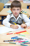 The boy draws. Felt-tip pens royalty free stock photo