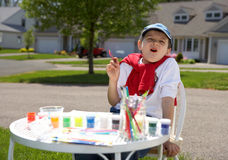 The boy draws. Paints outside Stock Images