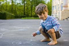 The boy draws with chalk Stock Photography