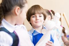 Boy draws in class with other children Royalty Free Stock Photo