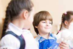 Boy draws in class with other children Stock Image