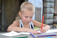 The boy draws Stock Photos