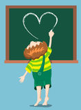 Boy draws heart. Stock Image