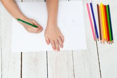 The boy draws jellyfish with colored pencils on paper. Flat lay. The boy draws jellyfish with colored pencils on paper. top view Stock Images