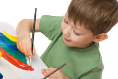 Boy draws with paints Royalty Free Stock Images