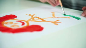 Boy Draws Paints on White Paper stock video footage