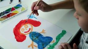 Boy Draws Paints on White Paper stock video