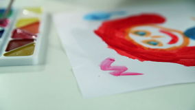 Boy Draws Paints on White Paper stock footage