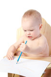 A boy draws with a pencil. On white background Stock Photos