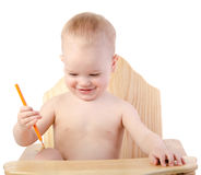 A boy draws with a pencil. On white background Royalty Free Stock Images