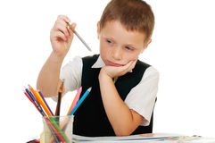 The boy draws pencils in an album on a white background Royalty Free Stock Images