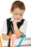 The boy draws pencils in an album on a white background Royalty Free Stock Photo