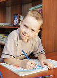 Boy draws with pencils in a notebook Stock Image