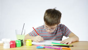 Boy draws a picture of a pencil stock footage