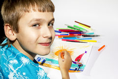 The boy draws a picture set of multicolored marker Stock Image