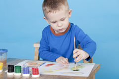 boy draws pictures Royalty Free Stock Images