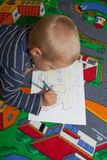 The boy draws pictures. Stock Photos