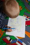 The boy draws pictures. Royalty Free Stock Image
