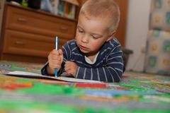 The boy draws pictures. Stock Image