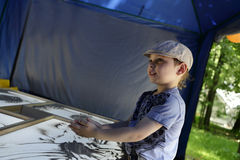 Boy draws with sand Royalty Free Stock Photo