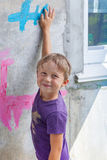 Boy draws on the wall Royalty Free Stock Image