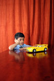 Boy with dream car Stock Photography