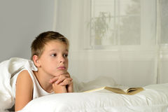 Boy is dreaming Royalty Free Stock Photo