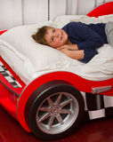 Boy is dreaming in bed. Boy dreaming in his car bed Stock Photography