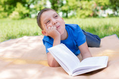 Boy dreaming on the book. Selective focus royalty free stock photo