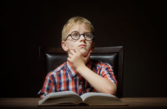 Boy dreaming with a book Stock Images