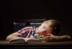Boy dreaming with a book Royalty Free Stock Photo
