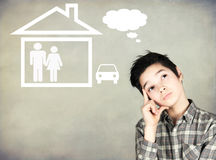 Boy dreaming of the future. Boy dreaming of the family and home Royalty Free Stock Photo
