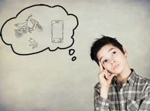 Boy dreaming. Of material goods Stock Image
