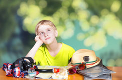 Boy dreaming of vacations Stock Photos