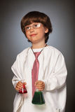 Boy dreams of becoming a chemist Stock Photos