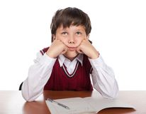 The boy dreams in a class Royalty Free Stock Image