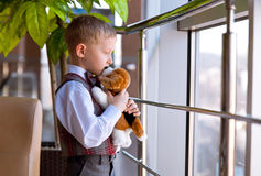 Little boy with puppy toy Stock Images