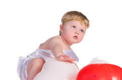 Boy dressed as angel with white and red balloons Stock Images