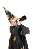 Boy dressed as astrologer. Isolated. Boy dressed as astrologer looking through a telescope. Isolated royalty free stock image