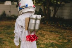 Boy dressed as astronaut with a toy jetpack royalty free stock images