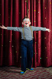 Boy Dressed as Clown Performing on Stage Stock Photography