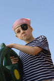Boy Dressed As Pirate Holding A Steering Wheel Stock Photography