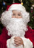 Boy Dressed as Santa Stock Images